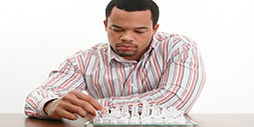 man playing chess Welcome to Nigerian Stockbrokers Limited Welcome to Nigerian Stockbrokers Limited man playing chess